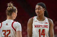 COLLEGE PARK, MD - NOVEMBER 20: Diamond Miller #14 talks with Sara Vujacic #32 of Maryland during a game between George Washington University and University of Maryland at Xfinity Center on November 20, 2019 in College Park, Maryland.