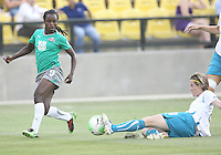 Eniola Aluka #9 of Abby's XI has her cross stopped by Sonia Bompastor #8 of Marta's XI during the WPS All-Star game at KSU Stadium in Kennesaw, Georgia on June 30 2010. Marta XI won 5-2.