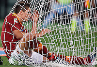 Calcio, Serie A: Roma vs Lazio. Roma, Stadio Olimpico, 8 aprile 2013..AS Roma forward Erik Lamela, of Argentina, reacts after missing a scoring chance during the Italian serie A football match between A.S. Roma  and Lazio at Rome's Olympic stadium, 8 april 2013..UPDATE IMAGES PRESS/Riccardo De Luca