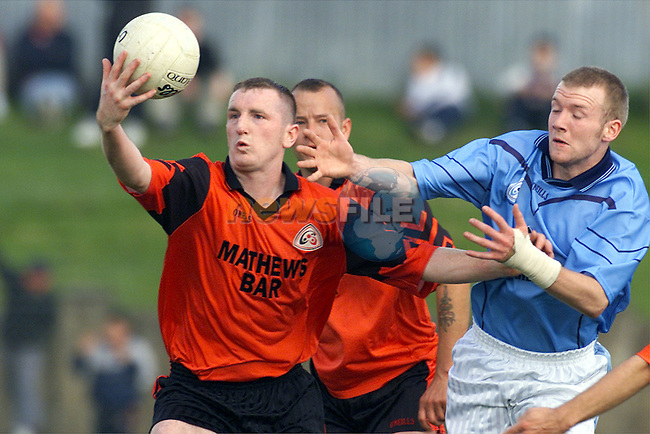 Newtown Blues' Eoghan Judge and Mattock Rangers' Christy Grimes in action in the Louth Senior Football Championship Final..Picture: Paul Mohan/Newsfile