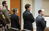 Convicted sniper John Allen Muhammad, left, stands along with his defense team, Peter Greenspun, right, Jonathan Shapiro, second from right, and Christie Leary, as the judge enters the courtroom at the Virginia Beach Circuit Court in Virginia Beach, Virginia on Monday November 24, 2003.  The jury is beginning its second day of deliberation in the sentencing phase of the trial. <br /> Credit: Davis Turner - Pool via CNP