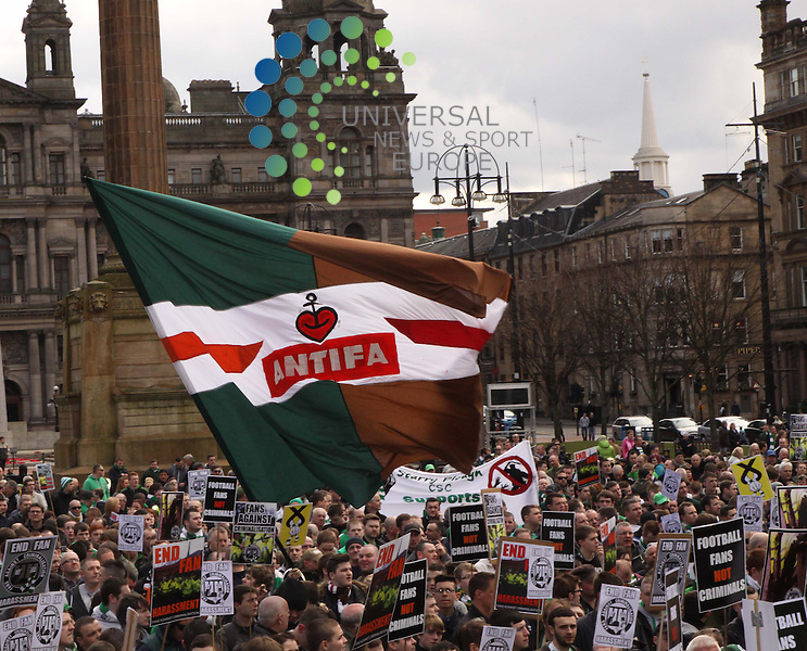 Hundreds of people have protested in Glasgow against the perceived ill-treatment of football fans. Protesters gathered for the rally by Fans Against Criminalisation - an organisation of Celtic fans' groups. The city council agreed to the George Square event but declined permission for a parade. Police had warned fans not to stage an &quot;illegal&quot; march. An unauthorised march by the Green Brigade group of Celtic fans in Glasgow last month saw 13 arrests made.<br />