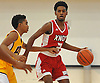 Kareem Holmes #3 of The Knox School (St. James), right, dribbles downcourt under pressure during a non-league game against Our Saviour Lutheran (Bronx) in the inaugural Empire Invitational at Adelphi University on Saturday, Jan. 7, 2017. Lutheran defeated Knox by a score of 74-66.