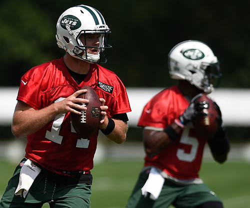 Sam Darnold #14, New York Jets rookie quarterback, left, throws a pass alongside veteran signal caller Teddy Bridgewater #5 during Training Camp at the Atlantic Health Jets Training Center in Florham Park, NJ on Saturday, Aug. 18, 2018.