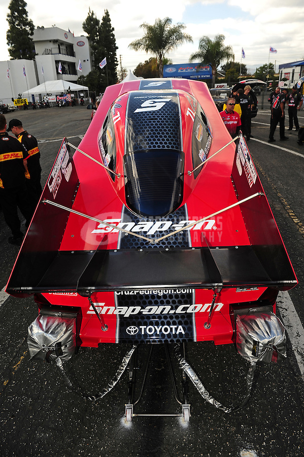 Feb. 24, 2011; Pomona, CA, USA; NHRA funny car driver Cruz Pedregon during qualifying for the Winternationals at Auto Club Raceway at Pomona. Mandatory Credit: Mark J. Rebilas-