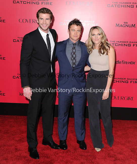 LOS ANGELES, CA - NOVEMBER 18: Liam Hemsworth and Luke Hemsworth arrives at   THE HUNGER GAMES: CATCHING FIRE L.A. Premiere held at Nokia Live  in Los Angeles, California on November 18,2012                                                                               © 2013  Hollywood Press Agency