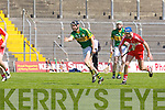 Kerry's Darren Dineen gets his pass away against Derry's Kevin Hinphey at Austin Stack park, Tralee on Saturday.