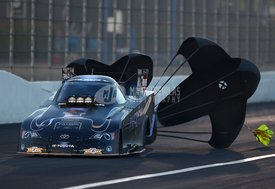 Feb 8, 2014; Pomona, CA, USA; NHRA funny car driver Alexis DeJoria during qualifying for the Winternationals at Auto Club Raceway at Pomona. Mandatory Credit: Mark J. Rebilas-