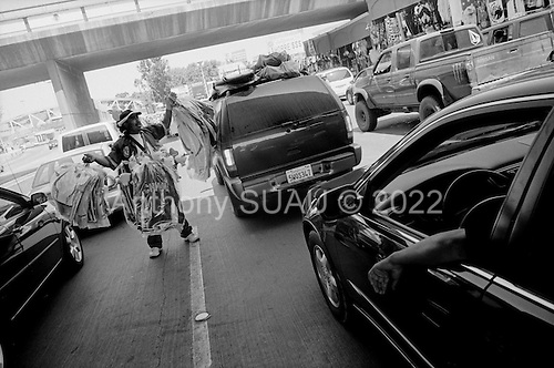 Tijuana, Mexico<br /> August 19, 2007<br /> <br /> The Mexican US border crossing from the Mexican side as people wait many hours to cross in to the US on a Sunday. The crossing is the busiest border crossing in the world and lines to wait for US entry are often many hours.<br /> <br /> Vendors and trinket shops take advantage of the bored potential customers.