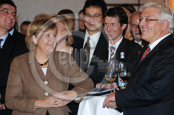 BERLIN - GERMANY 24. 10. 2006 -- German Foreign Correspondents' Association's (VAP) 100th anniversary in Berlin. German Chancellor Angela Merkel (L) and Foreign Minister Frank-Walter Steinmeier (R) -- PHOTO: GORM K. GAARE / EUP- IMAGES .