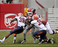 NWA Democrat-Gazette/BEN GOFF @NWABENGOFF<br /> Alex Collins, Arkansas running back, attempts to break the tackle of UTEP defenders Michael Lewis (39) and Trey Brown on Saturday Sept. 5, 2015 during the first quarter of the game in Razorback Stadium in Fayetteville.