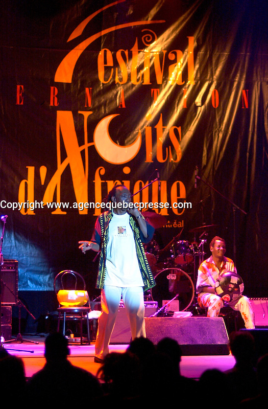 July 16 2002, Montreal, Quebec, Canada<br /> <br /> Thomas Mapfumo, from Zimbamwe, plays the Spectrum, in Montreal, Canada, July 16, 2002 during the Nuits d'afrique Festival<br /> <br /> Thomas Mapfumo, the Lion of Zimbabwe, is an Afro-Pop legend whose recipe of mbira traditions infused with jit, jazz, rumba and soul make him the undisputed king of chimurenga. <br /> <br /> Mandatory Credit: Photo by Pierre Roussel- Images Distribution. (&copy;) Copyright 2002 by Pierre Roussel <br /> <br /> NOTE : <br />  Nikon D-1 jpeg opened with Qimage icc profile, saved in Adobe 1998 RGB<br /> .Uncompressed  Uncropped  Original  size  file availble on request.