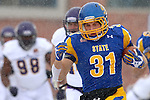 BROOKINGS, SD - NOVEMBER 15: Zach Zenner #31 from South Dakota State University breaks loose past a host of defenders from Western Illinois for a touchdown in the first quarter Saturday afternoon at Coughlin Alumni Stadium in Brookings. (Photo by Dave Eggen/Inertia)