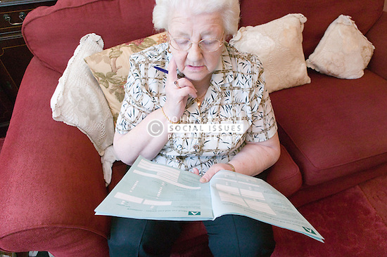 Older woman struggling to fill out housing benefit form,