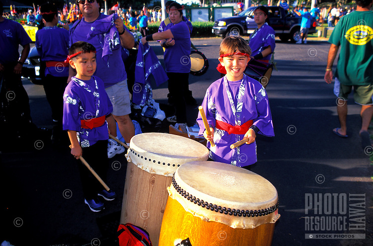 Children with japanese drums participate in a parade for the annual Aloha Week Festival.These photos taken on the island of Maui predeeding the parade.