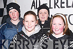 CHEERS: Young supporters cheer on the victorious Ardfert Intermediate Team as they arrive home in Ardfert on Sunday night. L-r: David Fitzgerald, Greise Moran, Padraig McGarty and Sarah Fitzgerald. .
