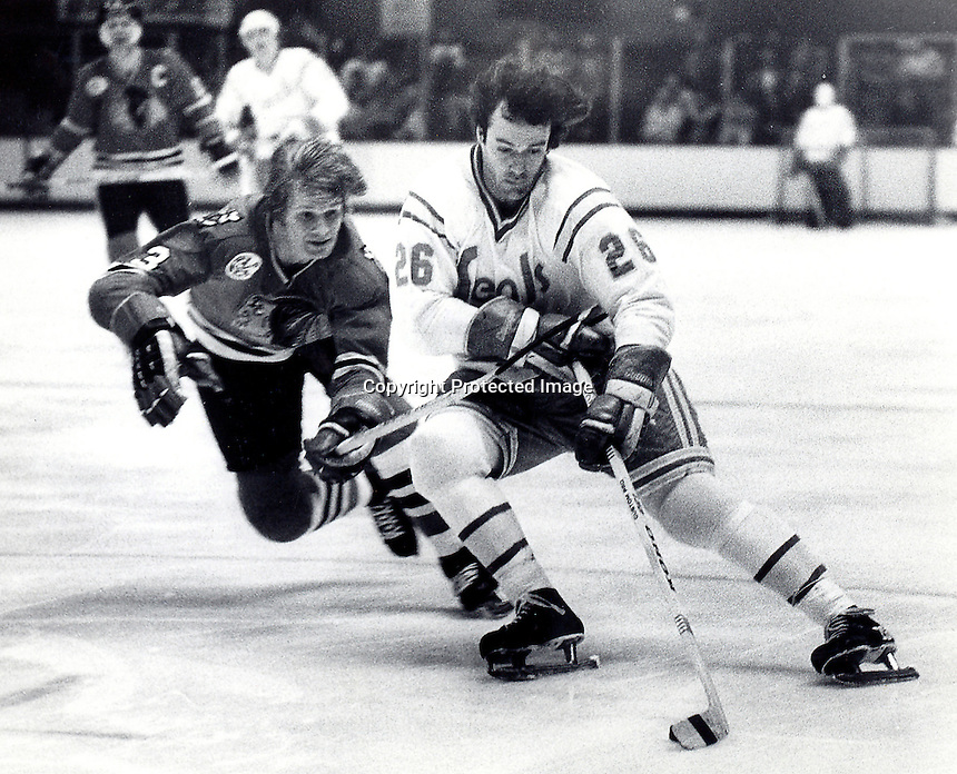 California Golden Seals Bob Girard chased by Chicago Black Hawk Keith Magnuson. photo/Ron Riesterer