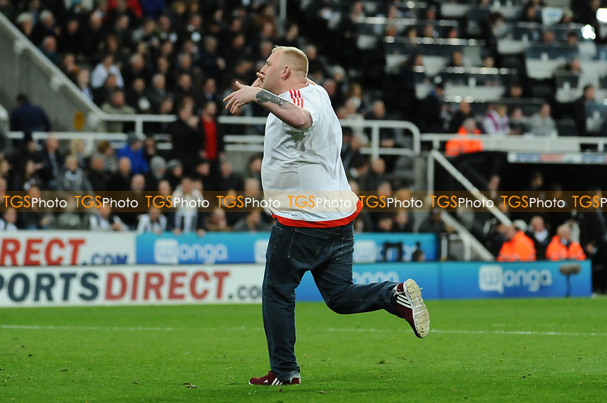 A pitch invader runs onto the pitch during Newcastle United vs Leeds United, Sky Bet EFL Championship Football at St. James' Park on 14th April 2017