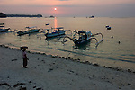 A sunset drops below the island of Bali, seen from Nusa Lembongan, Bali, Indonesia, Pacific Ocean