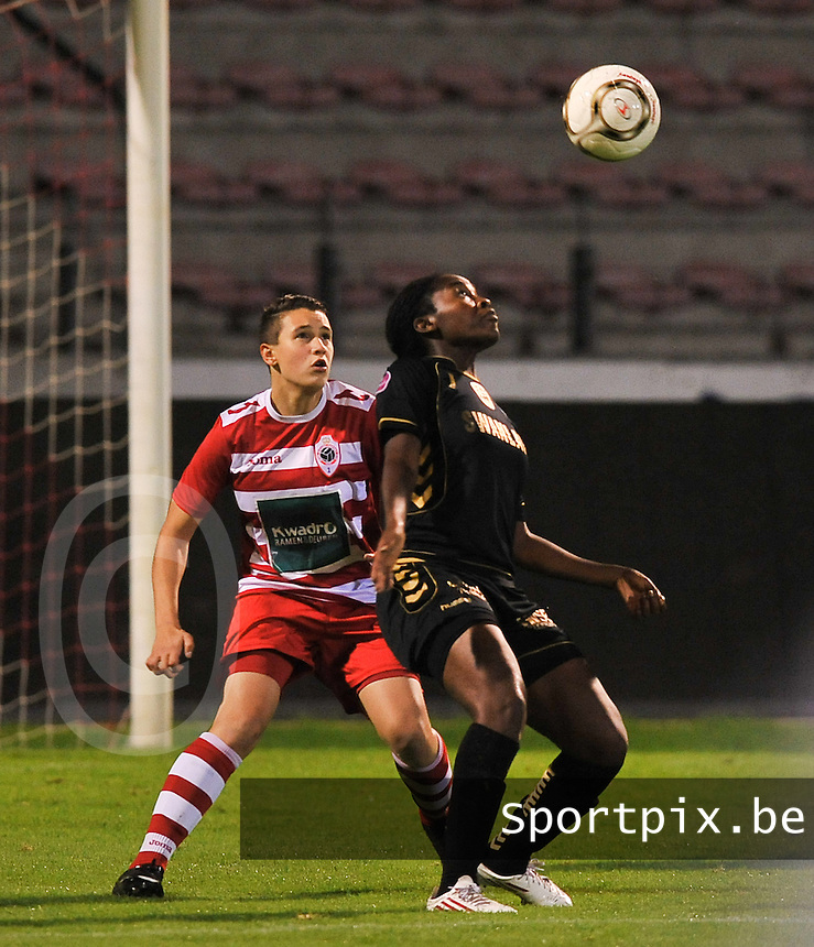 20131018 - ANTWERP , BELGIUM :  Telstar Lavinia Poku (right) pictured with Antwerp Charlotte Andries (left) during the female soccer match between Royal Antwerp FC Ladies and Telstar Vrouwen Ijmuiden , of the Eight' matchday in the BENELEAGUE competition. Friday 18 October 2013. PHOTO DAVID CATRY