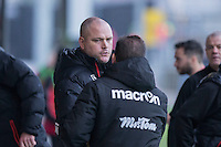 Morecambe manager Jim Bentley greets Newport County manager Graham Westley ahead of the Sky Bet League 2 match between Newport County and Morecambe at Rodney Parade, Newport, Wales on 10 December 2016. Photo by Mark  Hawkins.