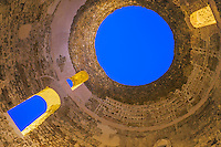 Diocletian's Palace is an old Roman ruin in Split Croatia.  This is a domes roof near the church.  Normally photographed during the day when circle of sunlight appears on the dome walls.  This photo was taken well after sundown durning what photographers call the blue hour for obvious reasons.  The gold light coming through the arched windows is from electrical lights.