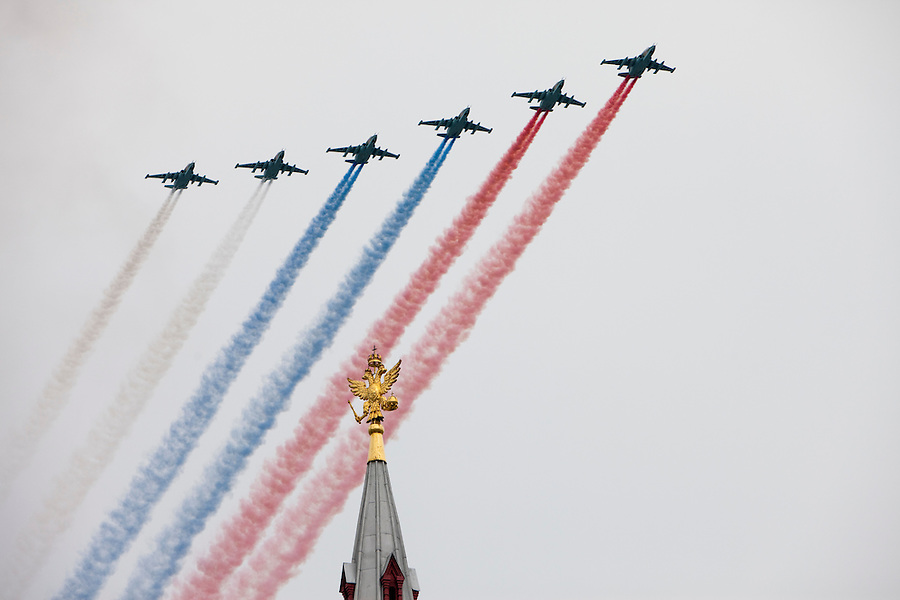 Moscow, Russia, 06/05/2010..Russian Su-25 fighter jets release smoke in the colors of the Russian flag over a Kremlin spire during a Red Square rehearsal for the forthcoming May 9 Victory Day parade, scheduled to be the largest for many years.