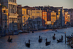 Gondoliers on the Grand Canal at sunset in Venice, Italy. .  John offers private photo tours in Denver, Boulder and throughout Colorado, USA.  Year-round. .  John offers private photo tours in Denver, Boulder and throughout Colorado. Year-round.
