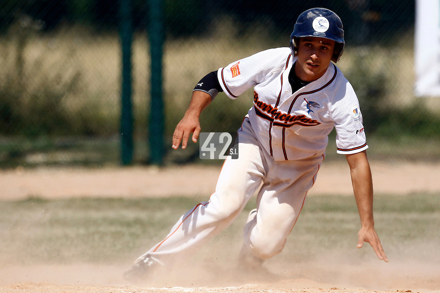 15 July 2011: Matt Lapinski of Montpellier slides safely into third base during the 2011 Challenge de France match won 10-7 by the Montpellier Barracudas over Montigny Cougars, in Les Andelys, near Rouen, France.