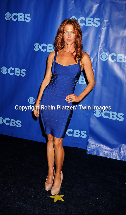 Poppy Montgomery in blue Herve Leger dress attending The CBS Upfront announcement of the Prime Time 2011-2012 Season on May 18, 2011 at Damrosch Park in  Lincoln Center in New York City.