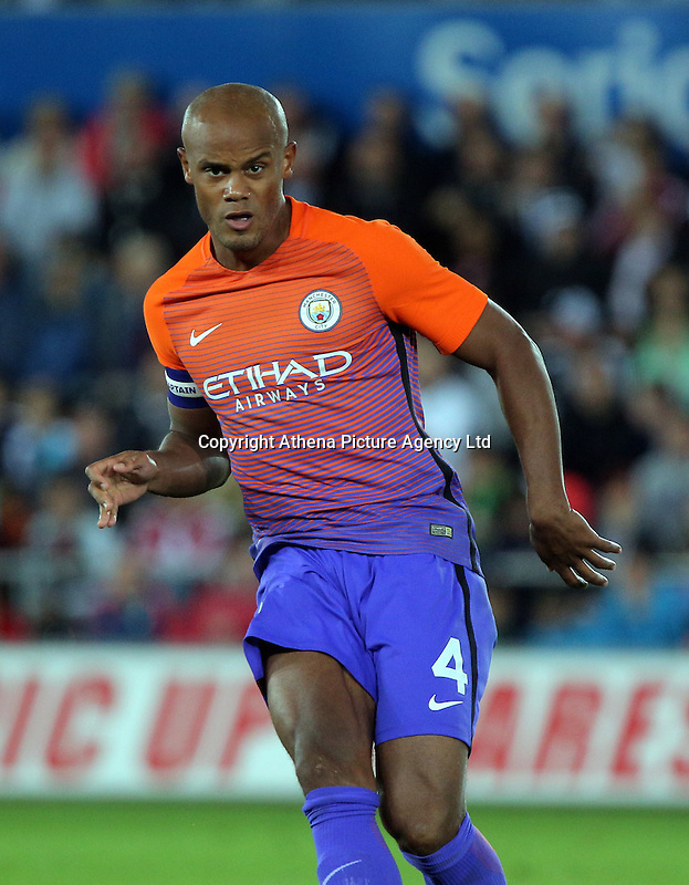 Vincent Company of Manchester City in action during the EFL Cup Third Round match between Swansea City and Manchester City at The Liberty Stadium in Swansea, Wales, UK. Wednesday 21 September.