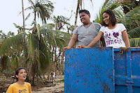 Philippines. Province Eastern Samar. Hernani. Barangay (neighbourhood) Carmel. Jessan Armendarez (center) and his cousins Lot-Lot Satiwan (right) et Alice Satiwan (left), they all sing a song and celebrate life. Truck destroyed by typhoon Haiyan's winds and storm surge. Typhoon Haiyan, known as Typhoon Yolanda in the Philippines, was an exceptionally powerful tropical cyclone that devastated the Philippines. Haiyan is also the strongest storm recorded at landfall in terms of wind speed. Typhoon Haiyan's casualties and destructions occured during a powerful storm surge, an offshore rise of water associated with a low pressure weather system. Storm surges are caused primarily by high winds pushing on the ocean's surface. The wind causes the water to pile up higher than the ordinary sea level. 27.11.13 © 2013 Didier Ruef