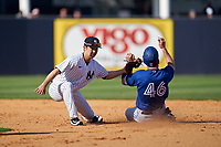 New York Yankees second baseman Hoy Jun Park tags Patrick Kivlehan (46) sliding in during a Spring Training game against the Toronto Blue Jays on February 22, 2020 at the George M. Steinbrenner Field in Tampa, Florida.  (Mike Janes/Four Seam Images)