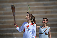 19th March 2020, Athens, Greece; The Olympic Flame, lit on Mount Olympia, is handed over officially to the  congregation from Japan, to be taken to Tokyo for the 2020 Olympic Games in July 2020. Greek Olympic medalist in pole vault Katerina StefanidiL holds the Tokyo Olympic Flame at the Panathenaic stadium, in Athens