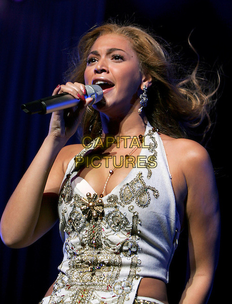 BEYONCE KNOWLES .Performs live with Destiny's Child  live at 100.3 The Beat Holiday Cooldown 2004 Concert held at The Universal Ampitheatre in Universal City, California, USA, .December 15th 2004..half length singing stage concert gig music gold silver beads pearls flower earrings jewellery beaded halterneck top necklace jewelled brooch broach.Ref: DVS.www.capitalpictures.com.sales@capitalpictures.com.©Capital Pictures.
