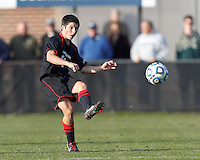 Northeastern University midfielder Dante Marini (14) passes the ball. .NCAA Tournament. University of Connecticut (white) defeated Northeastern University (black), 1-0, at Morrone Stadium at University of Connecticut on November 18, 2012.