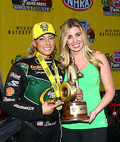 Feb 28, 2016; Chandler, AZ, USA; NHRA top fuel driver Leah Pritchett celebrates with friends after winning the Carquest Nationals at Wild Horse Pass Motorsports Park. Mandatory Credit: Mark J. Rebilas-