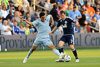 Omar Bravo (99) Sporting KC midfielder nips in ahead of Vancouver Whitecaps (7) Terry Dunfield... Sporting KC defeated Vancouver Whitecaps 2-1 at LIVESTRONG Sporting Park, Kansas City, Kansas.