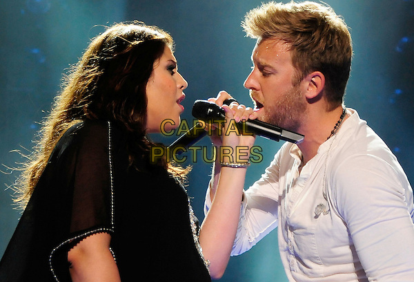 Hillary Scott, Charles Kelley, Lady Antebellum<br /> 2013 CMA Music Festival Nightly Concert held at LP Field,  Nashville, Tennessee, USA, <br /> 7th June 2013.<br /> music live on stage concert gig half length band group black microphone singing side duet profile white <br /> CAP/ADM/MS<br /> &copy;Mike Strasinger/AdMedia/Capital Pictures
