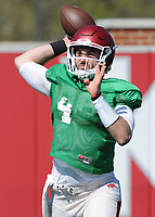 NWA Democrat-Gazette/ANDY SHUPE<br /> Arkansas quarterback Ty Storey rolls out to pass Saturday, April 1, 2017, during practice at the university practice field in Fayetteville. Visit nwadg.com/photos to see more photographs from practice.