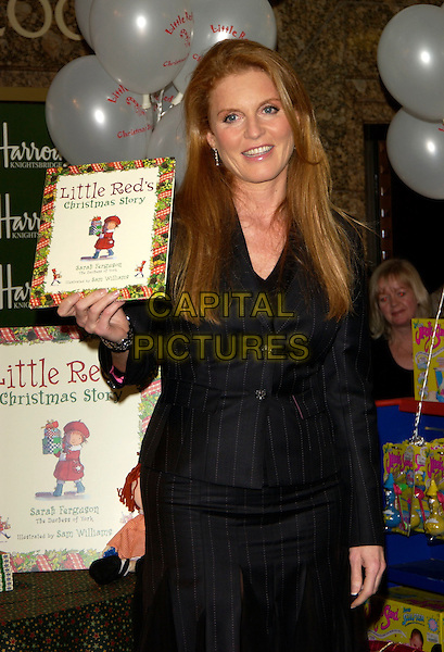 "SARAH FERGUSON, Duchess of York.Signs copies of her new book ""Little Red's Christmas Story"" ,Harrods , London 28  October 2004..half length pinstripe suit skirt .Ref: PL.www.capitalpictures.com.sales@capitalpictures.com.©Capital Pictures.."
