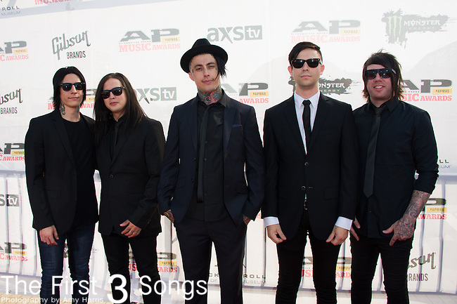 Ronnie Radke, Jacky Vincent, Derek Jones, Ryan Seaman, and Max Green of Falling In Reverse attends the 2014 AP Music Awards at the Rock And Roll Hall Of Fame and Museum at North Coast Harbor in Cleveland, Ohio.