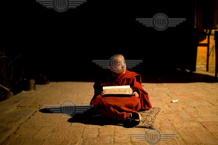 A child Tibetan monk studies at Rongwo monastery (Longwu in Chinese) in Rebkong (Tongren in Chinese).