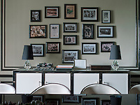 A collection of framed vintage photographs on one wall of the dining room record the historic moments from the founding of the Bentley brand up to the present day