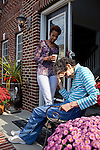 Karen Morris has been caring for her mother Gloria, 80, for the past 10 years. Her mother has Alzheimer's disease and lives with Karen and Karen's husband Richard in their Charlotte, NC home. The pair take in the morning sunshine on the front porch. ..Mrs. Morris was a nurse before she retired and really enjoys taking care of people, she said. Every morning she washes her mother in the bathroom, helps her walk down the stairs, and they share breakfast, as they did Monday, October 18, 2010...Gloria was having an especially bad day and because Karen sees her every day, she knew something was wrong. She later discovered her medication was dehydrating her. That is one of many reasons why having a regular caretaker is so important. ...Kendrick Brinson.LUCEO.Model Released: Yes.AARP Contract #4859.Wichita/Bellovin Bulletin