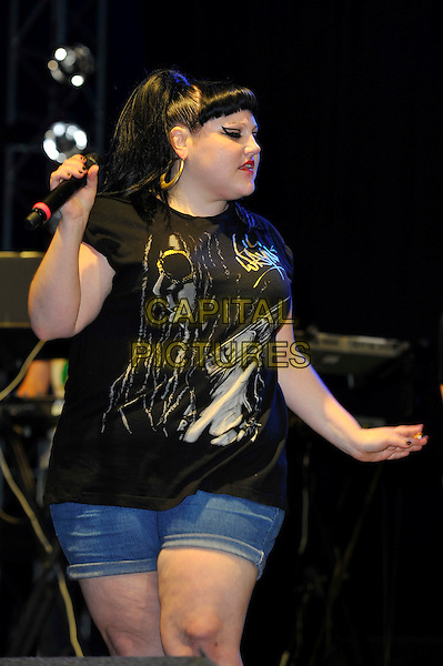 Beth Ditto of Gossip .performing at V Festival, Hylands Park, Chelmsford, Essex, England, UK, .18th August 2012..music live on stage concert half length black top t-shirt denim shorts microphone.CAP/MAR.© Martin Harris/Capital Pictures.