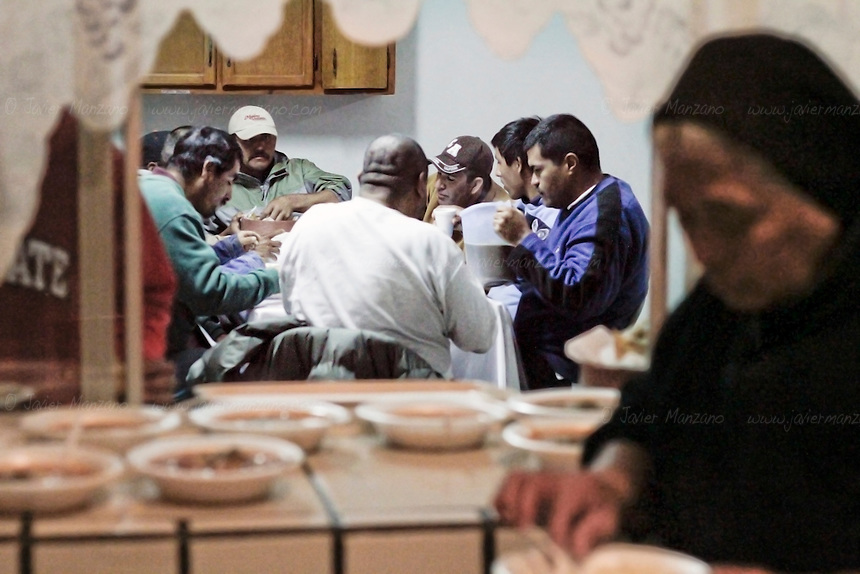 "Immigrants and travelers enjoy a free meal at ""Casa Migrante"", an immigrant shelter in Tecate, Baja California, Mexico on February 7, 2013.  This immigrant shelter houses and feeds thousands of immigrants every year. With a total capacity of 40 beds, male migrants can stay in the premises for a total of 4 nights before moving on. Places such as Casa Migrante are popular amongst immigrants and deportees making their way back into the United States. (Javier Manzano / For The Washington Post)."