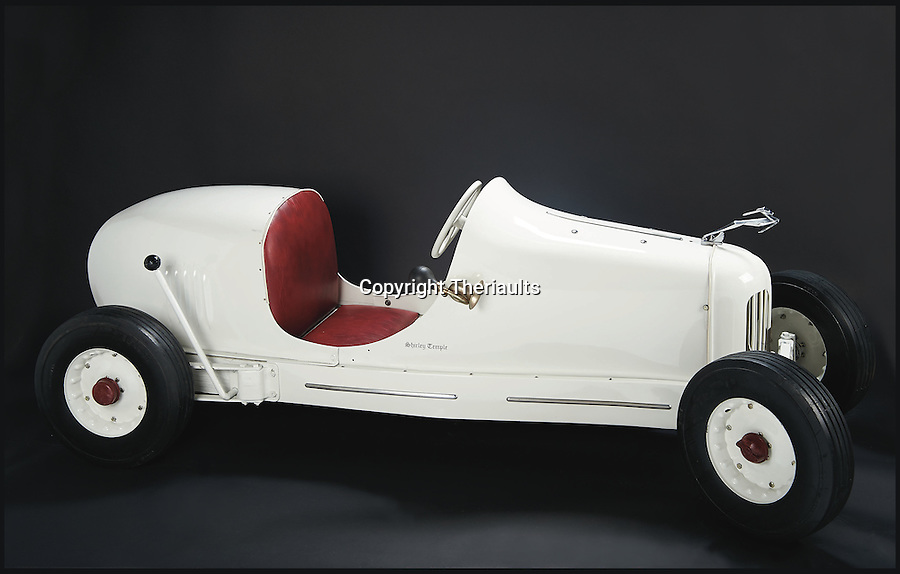 BNPS.co.uk (01202 558833)<br /> Pic: Theriaults/BNPS<br /> <br /> Shirley Temple's child-sized gas-powered tether racing car.<br /> <br /> The costumes worn by childhood movie star Shirley Temple during her Hollywood career make up a long-lost £1.5m collection belonging to the late actress.<br /> <br /> The curly-haired performer's parents made it a condition that she got to keep all of her outfits after filming rather than return them to the movie studios.<br /> <br /> The child costumes, that include the iconic red and white polka-dot dress the then six year old wore in her breakthrough role in the 1934 flick 'Stand Up and Cheer', have been locked away in a vault at her home for 75 years. They are being sold in Maryland, US.