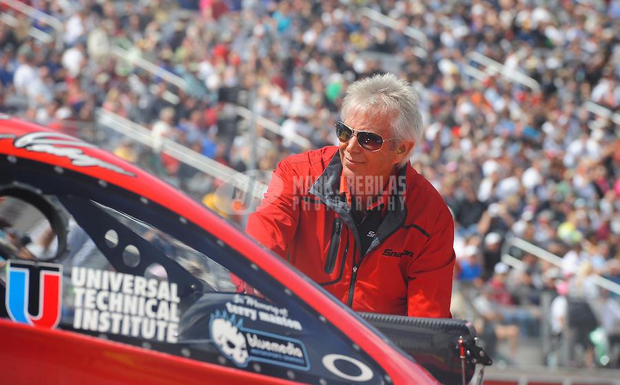 Apr. 1, 2012; Las Vegas, NV, USA: NHRA crew chief Lee Beard for funny car driver Cruz Pedregon during the Summitracing.com Nationals at The Strip in Las Vegas. Mandatory Credit: Mark J. Rebilas-