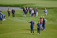 Ian Poulter (Team Europe) gives the crowd a thumbs up as he and Rory McIlroy (Team Europe) walk down 9 during Friday's foursomes of the 2018 Ryder Cup, Le Golf National, Guyancourt, France. 9/28/2018.<br /> Picture: Golffile | Ken Murray<br /> <br /> <br /> All photo usage must carry mandatory copyright credit (&copy; Golffile | Ken Murray)